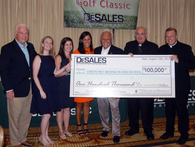 DeSales staff with check for Cristo Rey high school