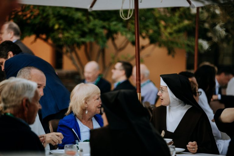 nuns and others at table