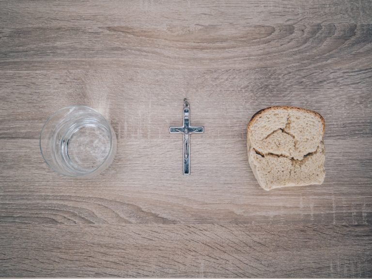 glass and crucifix and bread